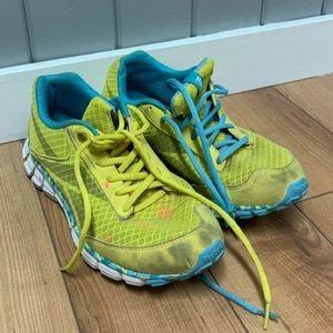 Neon yellow Reebok runners